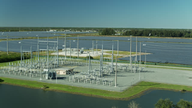 drone flight over equipment at barefoot bay solar energy center - power equipment stock videos & royalty-free footage