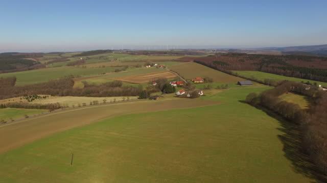 drone flight over farmland and farms, vierherrenborn, rhineland-palatinate, germany - rhineland palatinate stock videos & royalty-free footage