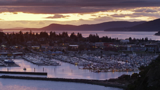 drone flight over fidalgo bay towards anacortes at twilight - anacortes stock videos & royalty-free footage