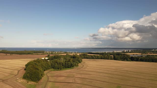 stockvideo's en b-roll-footage met drone flight over fields in autumn with blue sky and white clouds - tina terras michael walter