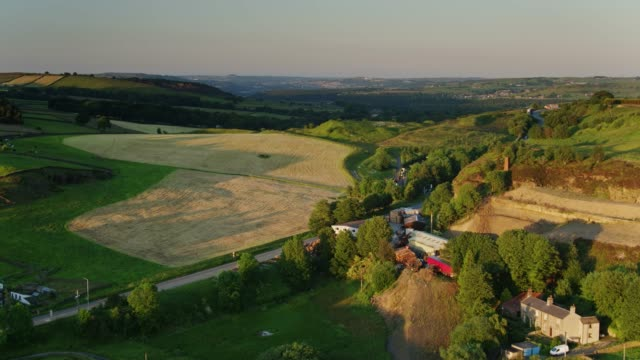 drone flight over fields near haworth, west yorkshire at susnet - yorkshire england stock videos & royalty-free footage