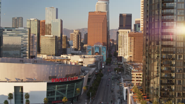 drone flight over figueroa st with staples center and la live - staples centre stock videos & royalty-free footage
