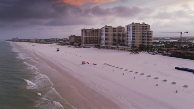 drone flight over fishing pier in clearwater beach - gulf of mexico stock videos & royalty-free footage