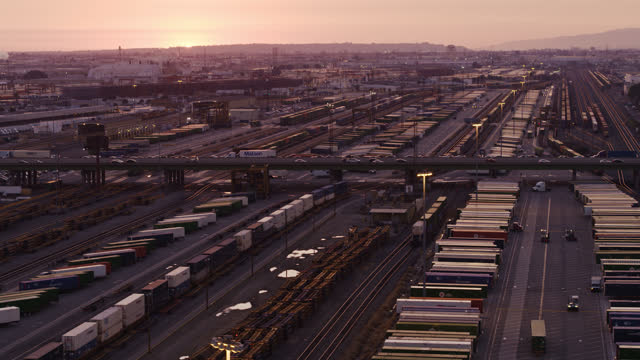 drone flight over freight yard in commerce, ca - dusk stock videos & royalty-free footage