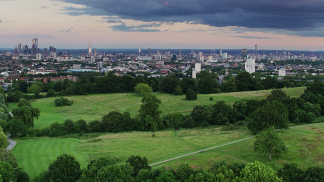 drone flight over hampstead heath towards london at dusk - establishing shot stock videos & royalty-free footage