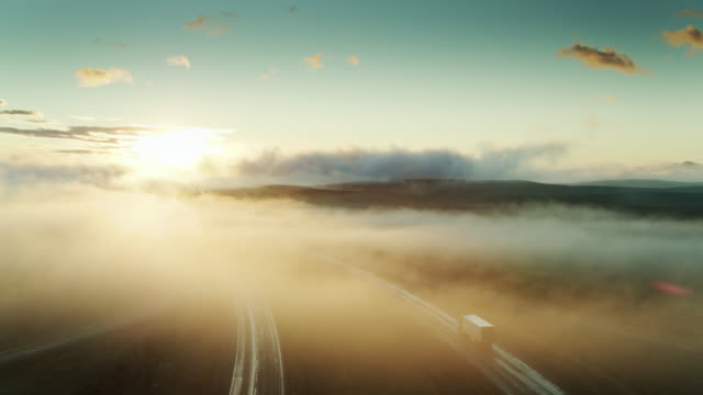 drone flight over interstate in morning mist - american interstate stock videos & royalty-free footage
