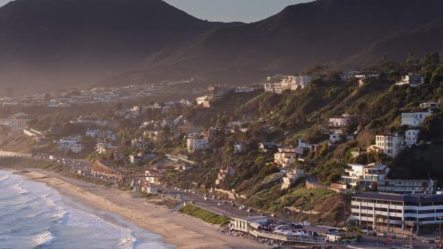 drone flight over malibu beach and downtown at dusk - malibu stock videos & royalty-free footage