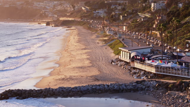 drone flight over malibu beach and downtown at dusk - malibu stock videos and b-roll footage