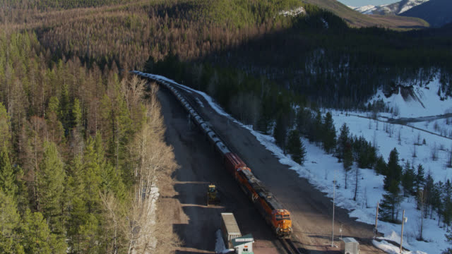 drone flight over oil train in rocky mountains - us glacier national park stock videos & royalty-free footage