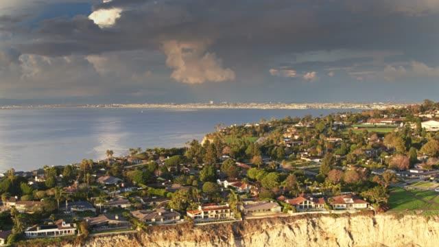 drone flight over palos verdes with la urban sprawl beyond - aerial - palos verdes stock videos & royalty-free footage