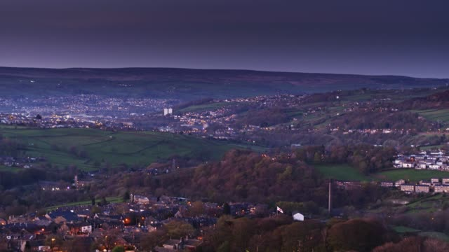 drone flight over pennine valley, england after sunset - west yorkshire stock videos & royalty-free footage