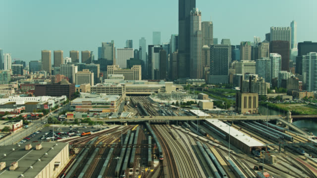 drone flight over rail yard on the edge of downtown chicago - willis tower stock videos & royalty-free footage