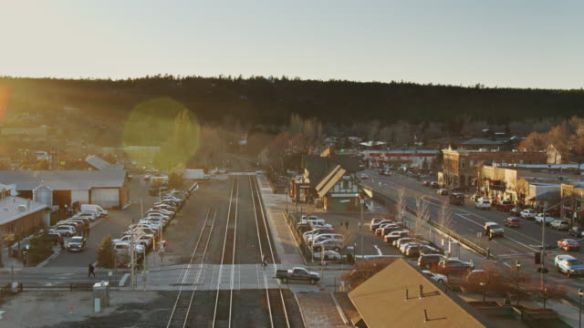 drone flight over railroad tracks in flagstaff, arizona - arizona stock videos & royalty-free footage
