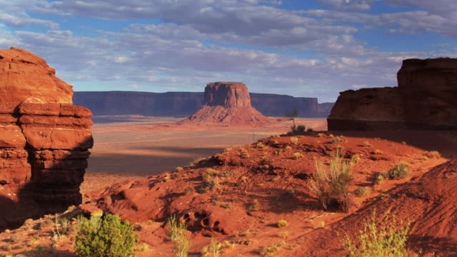 drone flight over ridge approaching merrick butte, monument valley - navajo reservation stock videos and b-roll footage