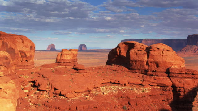 drone flight over ridge in monument valley - navajo reservation stock videos and b-roll footage