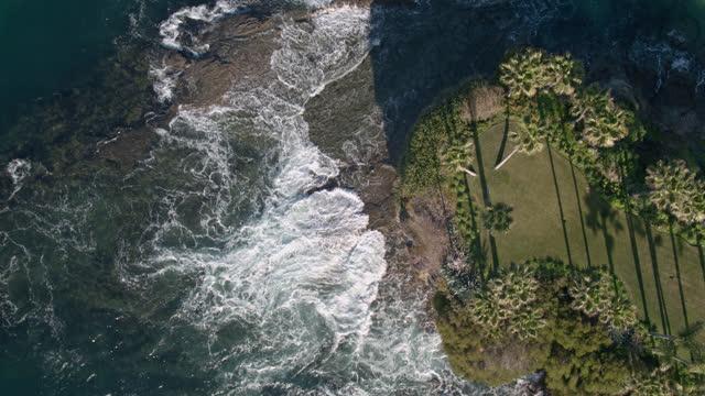 drone flight over rocky outcrop on orange county coast - laguna beach california stock videos & royalty-free footage