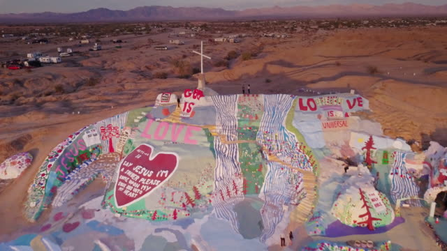 drone flight over salvation mountain - california stock videos & royalty-free footage