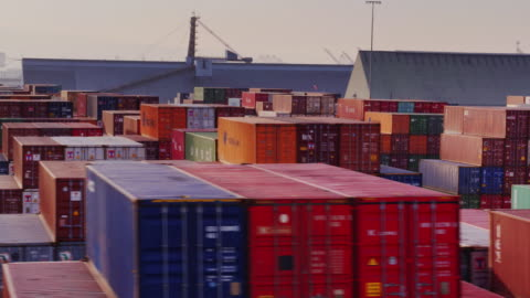 drone flight over shipping container yard - unloading stock videos & royalty-free footage