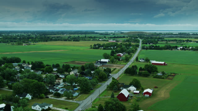 drone flight over small michigan town towards lake erie - michigan stock videos & royalty-free footage