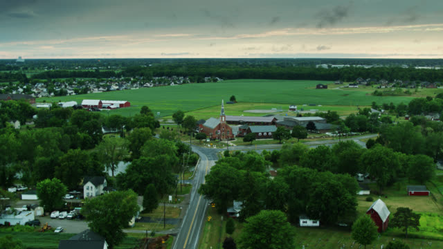 drone flight over small michigan town - michigan stock videos & royalty-free footage