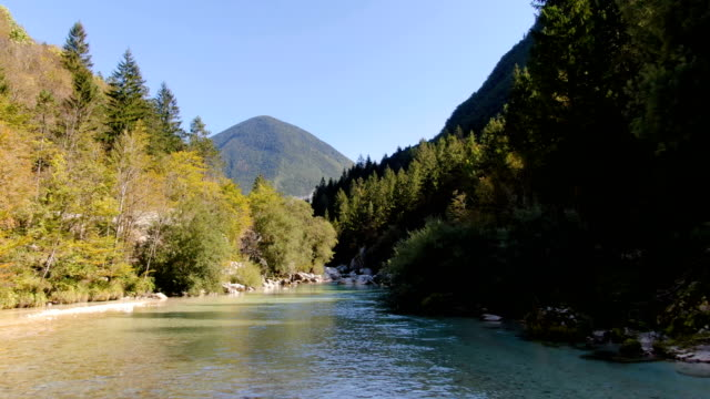 drone flight over soca river in mountain valley - slovenia stock videos & royalty-free footage