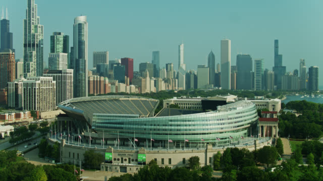 drone flight over soldier field revealing museum, park and chicago loop - chicago illinois stock videos & royalty-free footage
