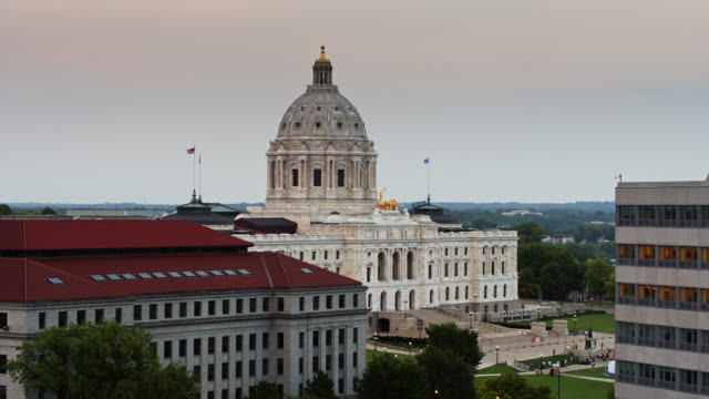 drone flight over state office buildings towards dome of minnesota state capitol - natural arch stock videos & royalty-free footage