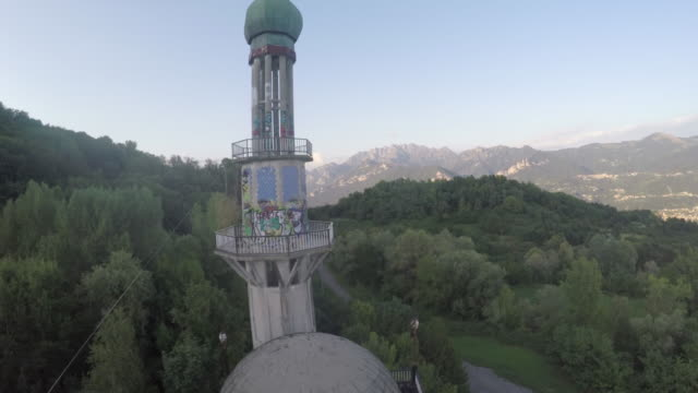 Drone flight over the ghost town of Consonno and the Alpes 4