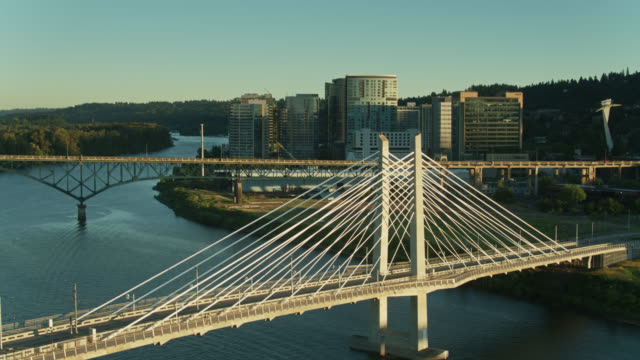 drone flight over tilikum crossing in portland at sunset - portland oregon sunset stock videos & royalty-free footage