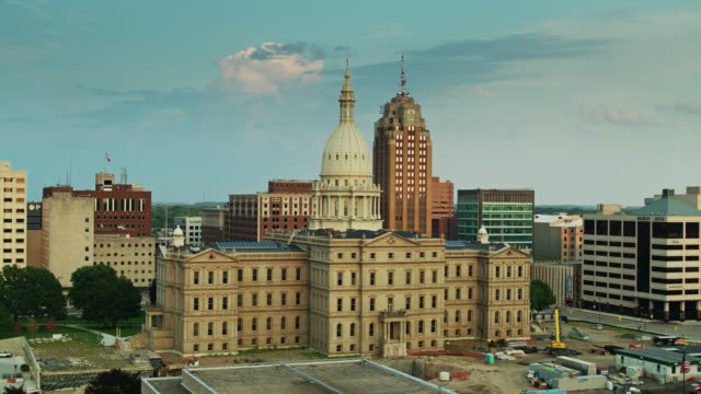 drone flight over van wagoner building towards michigan state capitol - lansing stock videos & royalty-free footage