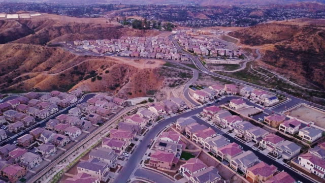 drone flight over vast development of single family homes - santa clarita stock videos & royalty-free footage