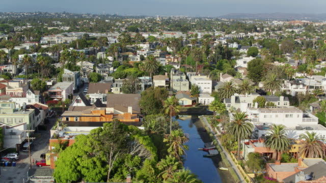 drone flight over venice canal historic district on sunny california day - canal stock videos & royalty-free footage
