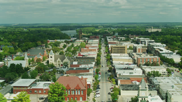 drone flight over vermont st and massachusetts street in lawrence, kansas - kansas stock videos & royalty-free footage