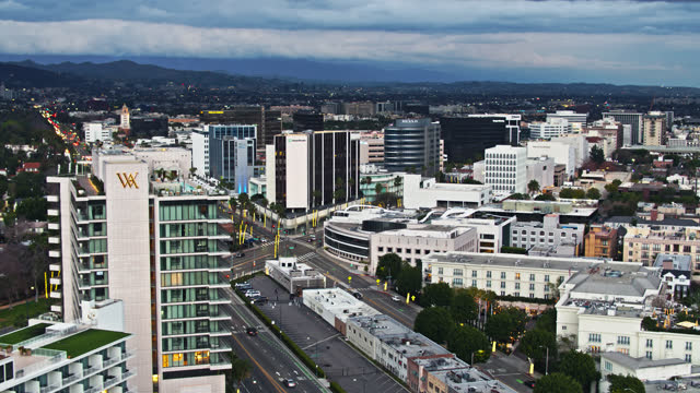 drone flight over wilshire boulevard in beverly hills - beverly hills california stock videos & royalty-free footage