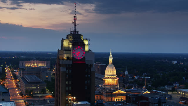 drone flight past boji clock tower in lansing at twilight - lansing stock videos & royalty-free footage