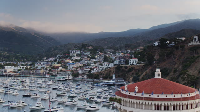 drone flight past catalina casino on hazy evening - channel islands california stock videos & royalty-free footage