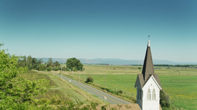 drone flight past church amid farmland in glenburn, california - church stock videos & royalty-free footage