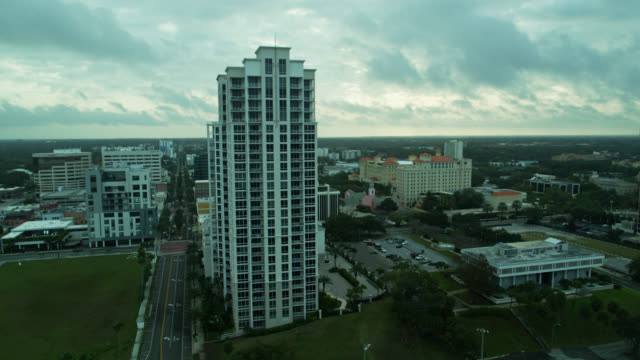 drone flight past condo tower in downtown clearwater, florida - gulf of mexico stock videos & royalty-free footage