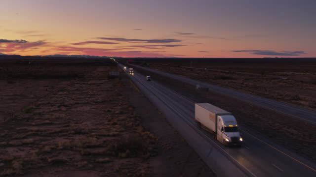 drone flight past oncoming trucks on interstate in the desert - interstate 10 stock videos & royalty-free footage