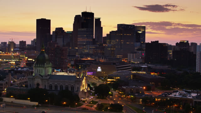 drone flight past st mary's basilica and downtown minneapolis before dawn - basilica stock videos & royalty-free footage