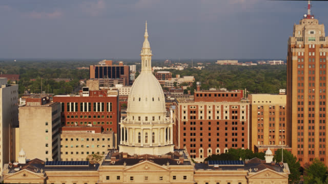 drone flight past state capitol building dome in lansing, michigan - lansing stock videos & royalty-free footage