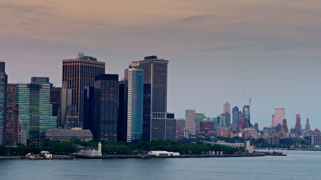 drone flight past the tip of lower manhattan with brooklyn behind - establishing shot stock videos & royalty-free footage