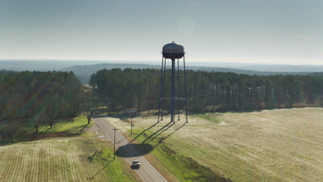 drone flight past water tower on the edge of banks, alabama - alabama video stock e b–roll