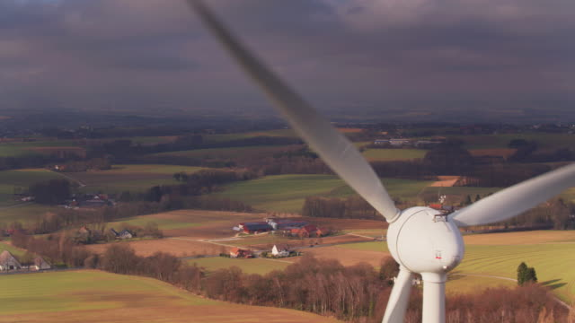drone flight past wind turbine near herford, germany - power supply stock videos & royalty-free footage