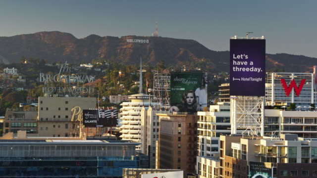 Drone Flight Through Billboards Towards the Capitol Records Building and the Hollywood Sign