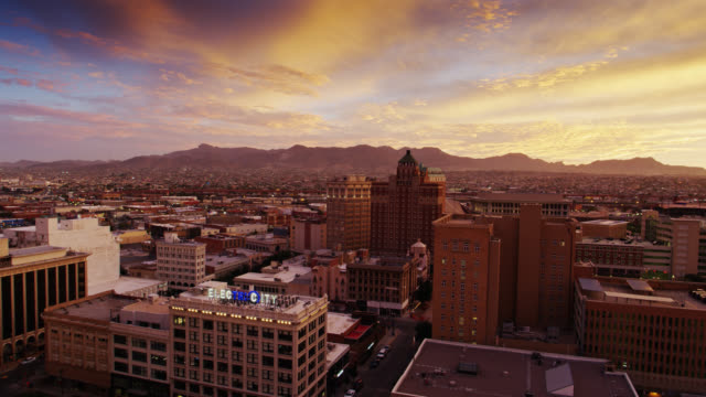drone flight through el paso towards ciudad juárez at sunset - el paso texas stock videos & royalty-free footage