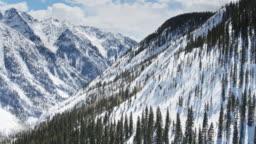 Drone Flight Through Steep Snowy Valley Near Durango, CO