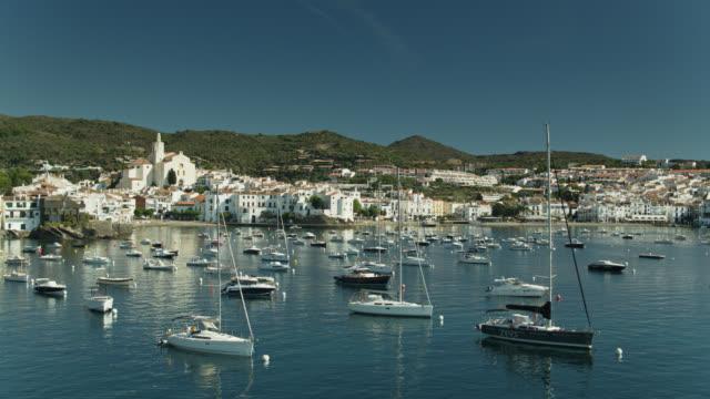 drone flight through the masts of sailboats moored off cadaqués - mediterranean sea stock videos & royalty-free footage