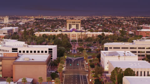 drone flight towards arizona state capitol at dawn - state capitol building stock videos & royalty-free footage