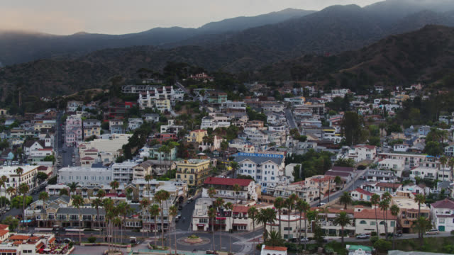 drone flight towards avalon on hazy summer evening on catalina island - channel islands california stock videos & royalty-free footage
